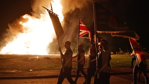 A loyalist band marches around the Ballycraigy estate during in Antrim last night