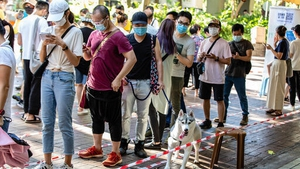 Voters queuing to cast their vote in the symbolic protest poll in Hong Kong