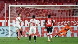 Lucas Ocampos scores from the penalty spot for Sevilla
