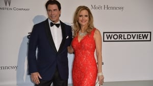 John Travolta and Kelly Preston at the amfAR 21st Annual Cinema Against AIDS during the 67th Cannes Film Festival in 2014