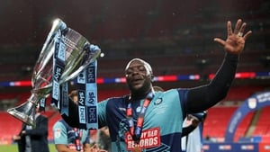 Akinfenwa celebrates with the trophy after the Sky Bet League One play-off final