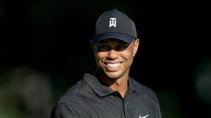 Tiger Woods smiles during a practice round prior to The Memorial Tournament