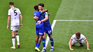 Kieffer Moore celebrates with Jamal Lowe Wigan's after scoring his team's fifth goal against Hull