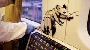 The video showed Banksy spray painting stencils of his famous rats on the Tube train