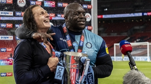 Adebayo Akinfenwa (R) has been invited to Liverpool's title parade