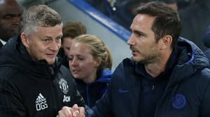 Ole Gunnar Solskjaer (L) and Chelsea manager Frank Lampard