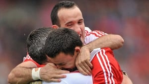 Cork goalkeeper Alan Quirke (R) celebrates with team-mates Graham Canty (L) and Kieran O'Connor at the end of the 2010 All-Ireland final