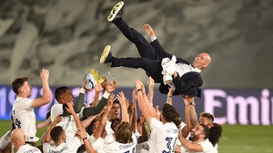Real Madrid head coach Zinedine Zidane is thrown up in the air by his players after being crowned league champions