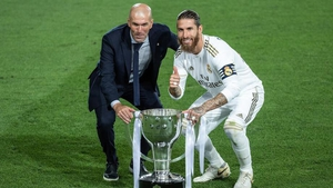 Sergio Ramos (R) and Zinedine Zidane celebrate with the league trophy