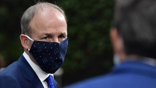 Taoiseach Micheál Martin arrives at the summit wearing a mask