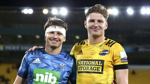 Beauden Barrett of the Blues and Jordie Barrett of the Hurricanes pose together after the match