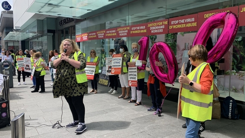 About 30 people are protesting outside Debenhams' Henry Street store this afternoon