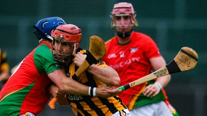 Ciarán Shaughnessy of Shelmaliers in action against Kevin Foley of Rapparees-Starlights