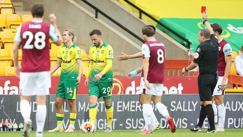 Norwich City finished with nine men in their 2-0 home defeat to Burnley