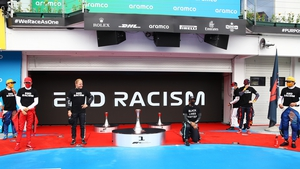 Lewis Hamilton takes a knee in support of the Black Lives Matter movement