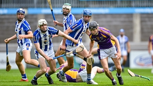 Coalán Conway of Kilmacud Crokes wheels away from Niall Ryan and Paddy Dunleavy