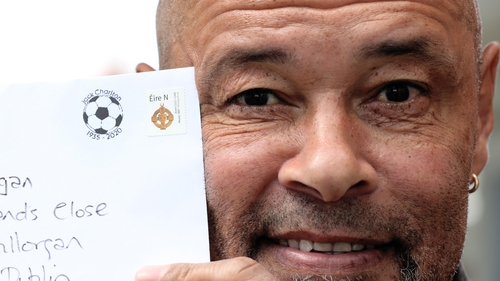 Former Republic of Ireland international Paul McGrath exhibits a letter with the Jack Charlton postmark
