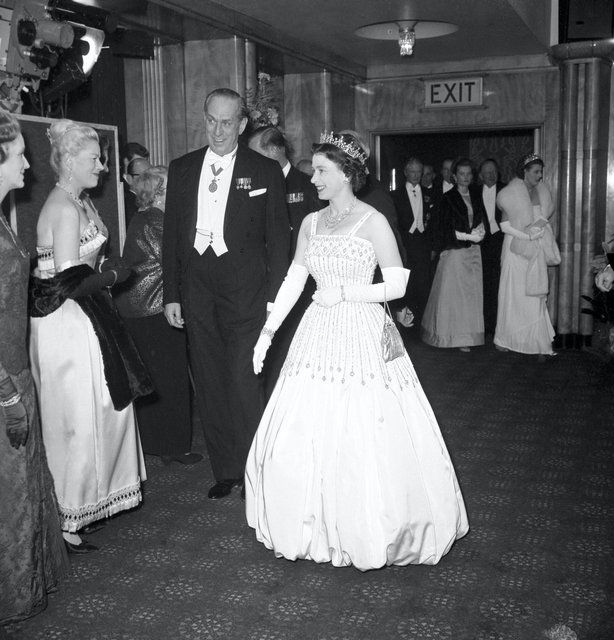 The Queen wearing the same Peau De Soie taffeta dress by Norman Hartnell for the world premiere of the film 'Lawrence of Arabia' in 1962