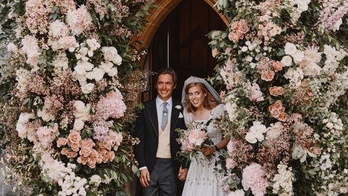 The bride wore an upcycled gown lent to her by Queen Elizabeth.