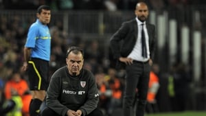 Marcelo Bielsa (C) and Pep Guardiola sharing a sideline in 2012 when they were in charge of Athletic Bilbao and Barcelona respectively
