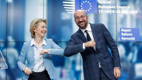 Ursula Von Der Leyen and Charles Michel bump elbows following the summit