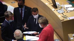 Angela Merkel, Emmanuel Macron and Pedro Sanchez pictured during the negotiations