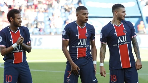 Neymar (L) and Kylian Mbappe (C) were on song against Celtic