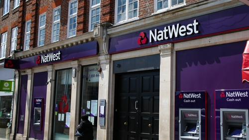 NatWest tumbles to first half loss on pandemic bad loan charge