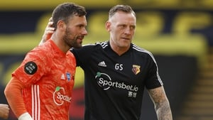 Ben Foster (L) is consoled by Graham Stack after the loss to Manchester City