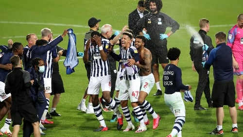 Goalscorer Callum Robinson (47) and his West Brom team-mates celebrate promotion