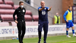 Paul Cook prowls the sideline during the draw against Fulham