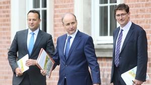 Micheál Martin, Leo Varadkar and Eamon Ryan acknowledged Mr Hogan's resignation