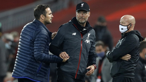 Liverpool manager Jurgen Klopp (R) and Chelsea manager Frank Lampard after the final whistle at Anfield