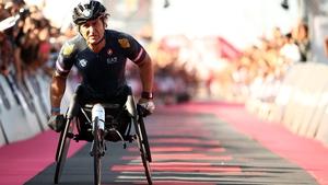 Alex Zanardi crosses the line at Ironman Italy last year