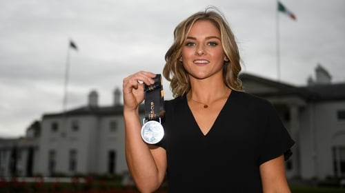 Chloe Watkins with her World Cup silver medal during a reception with the President at Áras an Uachtaráin