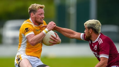 Drew Wylie tries to take the ball from Conor McManus