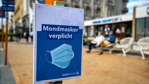 A sign reminds people in the Belgian coastal town of Nieuwpoort to wear face masks