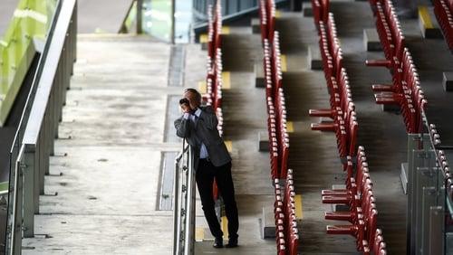 Trainer Tony Martin watches from the deserted stands at Ballybrit Racecourse