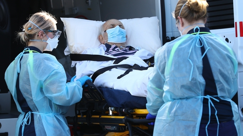A resident of Epping Gardens nursing home is transferred to a waiting ambulance