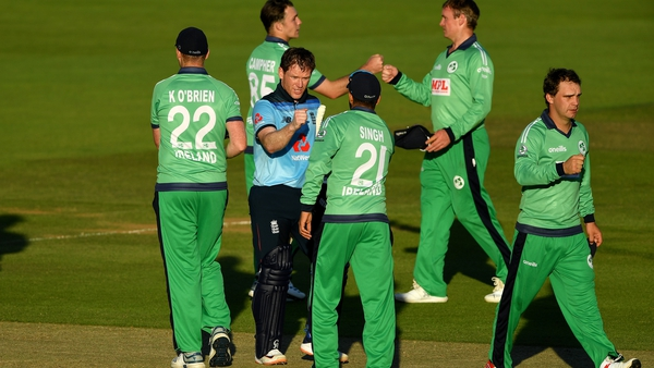 Eoin Morgan of England commiserates with Ireland after hitting the winning runs