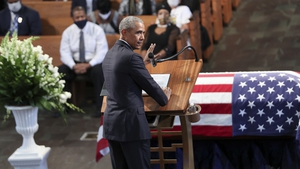 Barack Obama speaking during the funeral service of civil rights leader John Lewis