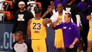 LeBron James celebrates victory with head coach Frank Vogel