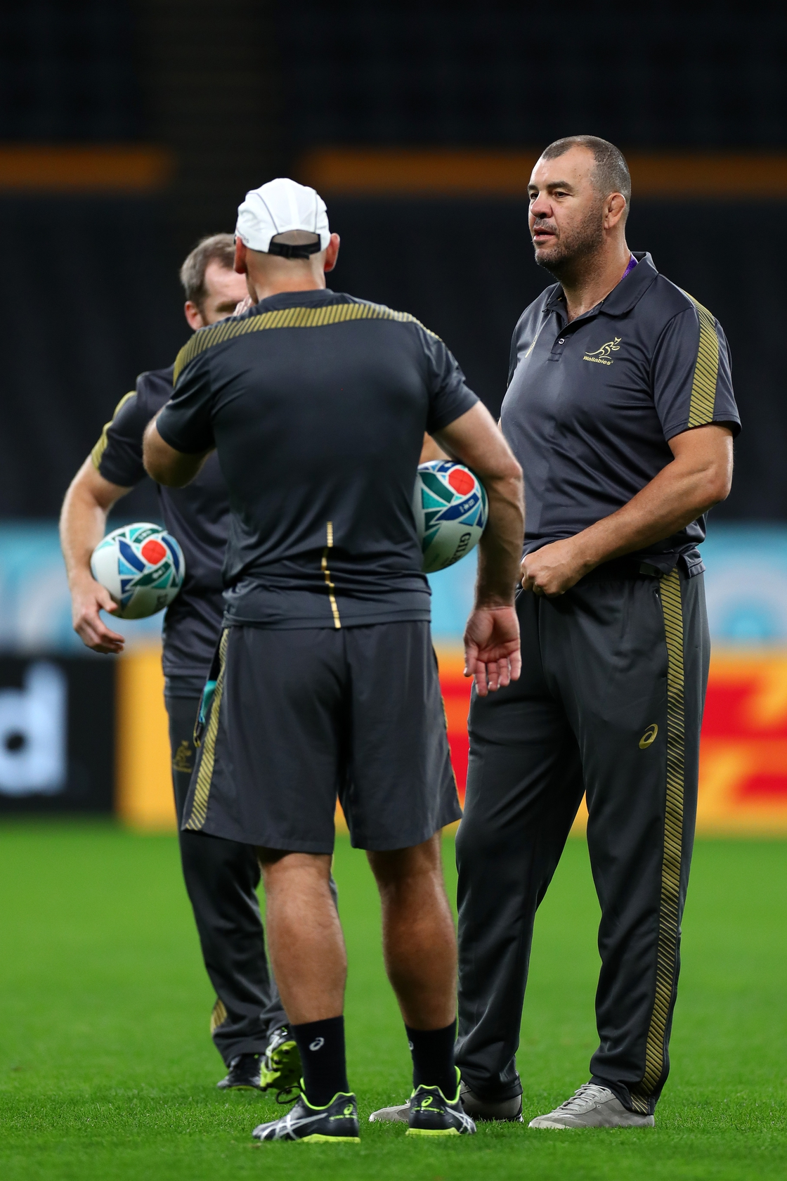 Image - Michael Cheika (r) at the 2019 World Cup with his coaches Nathan Grey and Shaun Berne