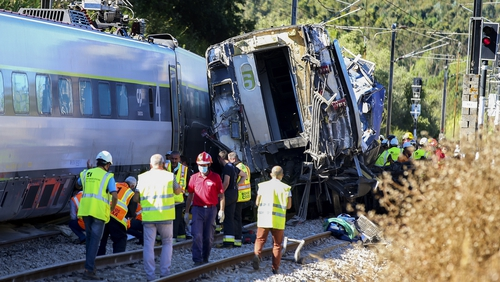 A high-speed train and a maintenance machine collided in central Portugal today