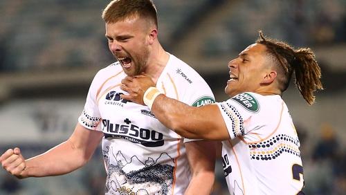 Mack Hansen (left) is congratulated after kicking a late winner