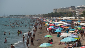 Thousands flocked to the Rincon Sol beach of Torremolinos, Spain