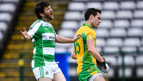 Corofin's Michael Farragher turns away after scoring his side's second goal as Ronan Molloy of Oughterard looks on dejected