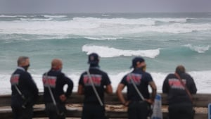 Palm Beach County Fire Rescue in Florida check out the ocean as waves crash ashore from Tropical Storm Isaias