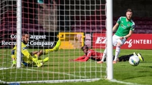 Andre Wright of Bohemians scores his side's first goal past Cork City goalkeeper Mark McNulty