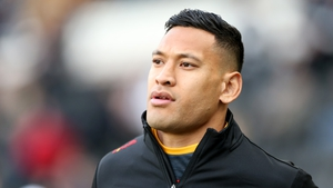 Folau remained standing as other players and officials made the gesture